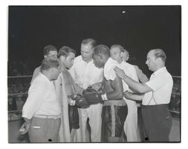 Boxers Barney Ross and Baby Joe Gans with others in ring at Multnomah Stadium, Portland