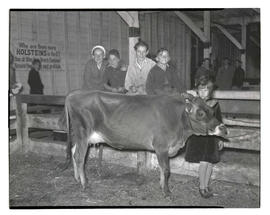 Children posing with cow