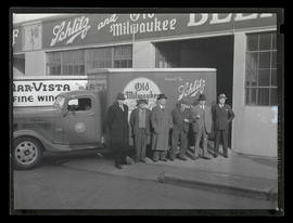 Group of men and truck outside Ballif Distributing Company, Southeast 2nd Avenue, Portland