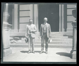 Jack Day and Robert Duncan? outside building