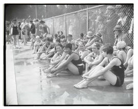 Children on deck at swimming pool