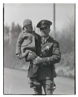 Oregon State Police trooper holding young boy