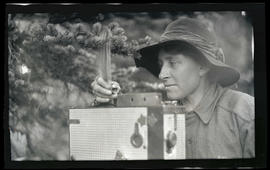 Irene Finley photographing a chipmunk