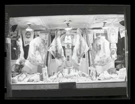 Window display of Swift's meats at Sealy-Dresser Company store