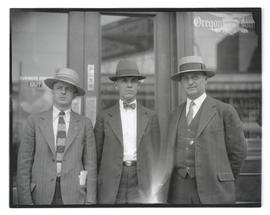 Three unidentified men outside Oregon Journal building, half-length portrait
