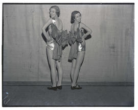 Two teenage dancers in costume