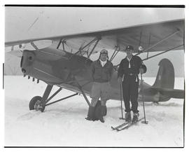 Two men with airplane in snow