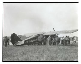 People gathered around Rankin brothers' airplane On-to-Oregon