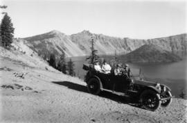 Auto on rim of Crater Lake