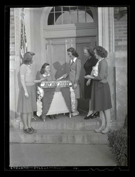 Marylhurst College students at war bond table, 1943?