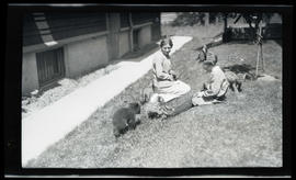 Irene and Phoebe Katherine Finley with bear cubs and cougar kittens