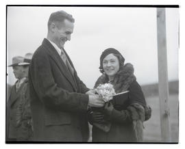 Man and woman, possibly at livestock show