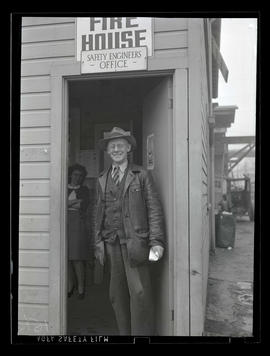 Employee at door of safety engineers office, Albina Engine & Machine Works, Portland