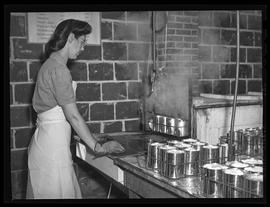Sterilizing cans at Garden Home community canning kitchen