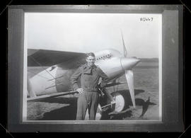 Photograph of Lieutenant Alexander Pearson, pilot, with Curtis R-8 airplane