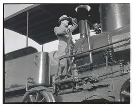 Tito Schipa posing on Oregon Pony locomotive