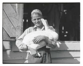 Boy holding rabbit