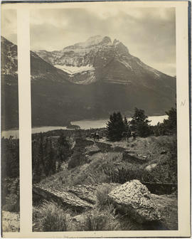 Red Eagle Mountain, Lake St. Mary, horsemen in foreground, Glacier National Park