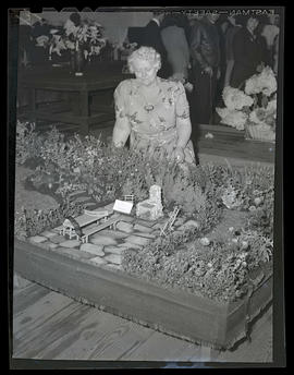 Woman with prize-winning garden model