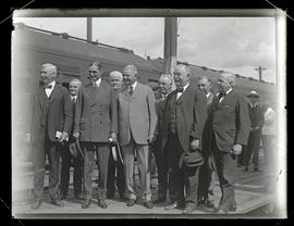 Willam Gibbs McAdoo with group of unidentified men on train platform