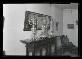Ornate clock and candle holders on table