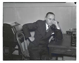 Earl Snell, using telephone