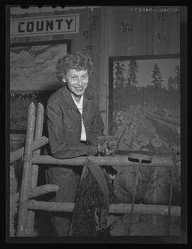 Person holding brand iron at Pacific International Livestock Exposition show, Portland