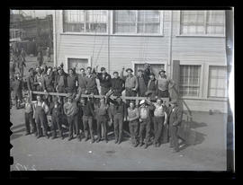 Workers posing outside building, Albina Engine & Machine Works, Portland