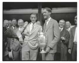 Frank Dolp? holding golf trophy and posing with group