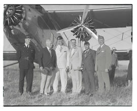 American Legion group posing with airplane in The Dalles