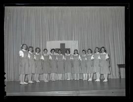 Red Cross nurses' aides on stage during capping ceremony at Marylhurst College, 1944