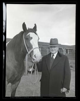 Governor Charles H. Martin with grand champion mare