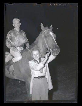 Woman with racehorse and jockey