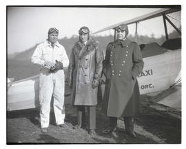 Tex Rankin, Richard E. Byrd, and Portland Police Chief Leon V. Jenkins next to airplane