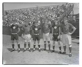 Six baseball players in front of stands