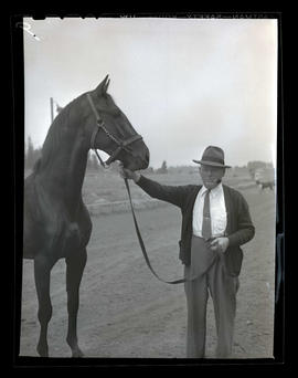 Man with racehorse named Sterling King