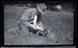 William Finley feeding cougar kittens