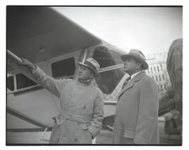 Tex Rankin and unidentified man next to airplane
