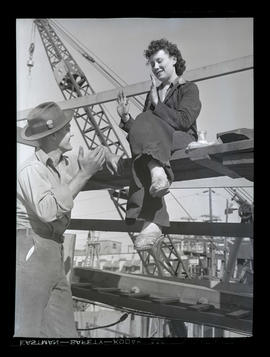 Jeannine Christensen? talking with unidentified man at Albina Engine & Machine Works, Portland