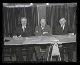 Washburne, Cahill, and Aldrich, seated at table
