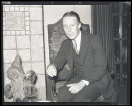 Dr. Dexter M. Keezer, president of Reed College, seated in chair