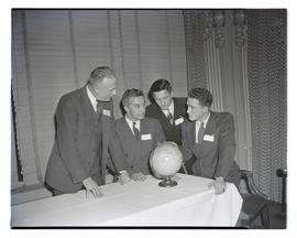 Four unidentified men with globe