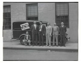 Six men with White King Soap Company truck