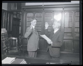 Judge Robert S. Bean administering oath of office to John H. McNary