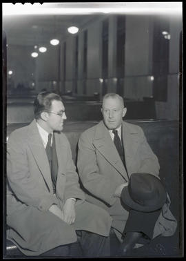 Perret and unidentified man