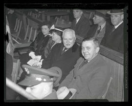 Joseph K. Carson and Charles H. Martin seated in stands