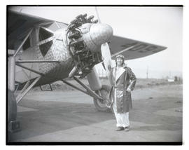 "Pilot Faye Carter with airplane ""Queen of the Cascades"""