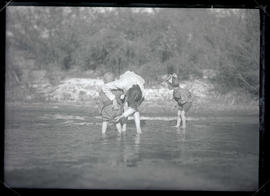 Irene Finley and children wading in creek