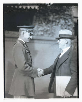 Lieutenant W. F. Browder and General Reeves shaking hands