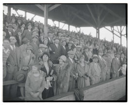 Spectators standing in bleachers at stadium